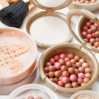 Women's cosmetics - powder, blush, brushes on the table — Stock Photo