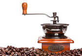 Coffee grinder and coffee beans isolated on white background — Stock Photo