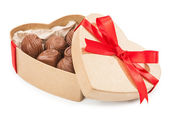 Chocolate candy in a box with a red bow — Stock Photo