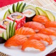 Fresh delicious sushi on a plate — Stock Photo