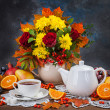 Autumn still life. Tea, flower and yellow leaves — Stock Photo
