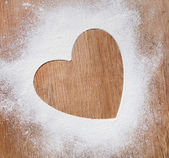 The heart of the flour on the table from the old boards. dramati — Stock Photo