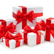 Gift boxes with red bows — Stock Photo
