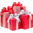 Red and striped boxes with gifts tied bows  — Stock Photo