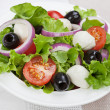 Dietetic food - fresh salad in plate on table — Stock Photo #36990193