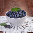 Blueberries in a bowl on a wooden table — Stock Photo