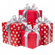 Red boxes with gifts tied with gray bows — Stock Photo