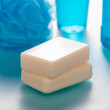 Cleanliness and Health - soap on a blue background bokeh — Stock Photo