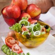Lettuce and apples in glass bowls on the table — Stock Photo