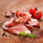 Slices of tasty spanish ham on board — Stock Photo #36990509