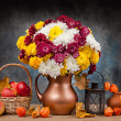 Autumn bouquet of apples in the basket, lantern on the table — Stock Photo
