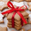 Christmas decoration. Cookies, red ribbon and bow  — Stock Photo