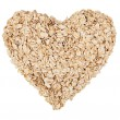 Oat flakes lying in a heart-shaped — Stock Photo