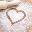 Heart of flour on wooden desk  — Stock Photo