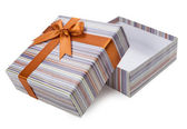 Open gift box with a brown bow — Stock Photo