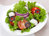 Dietetic food - fresh salad in a plate on the table — Stock Photo