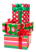 Boxes with gifts tied with red ribbon and bows — Stock Photo