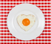 Egg in a heart-shaped served on a plate on the table — Stock Photo