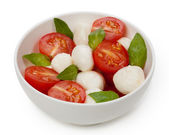Caprese salad with mozzarella, tomato, basil — Stock Photo