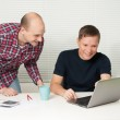 Two casual discuss the new project at office — Stock Photo #12561044