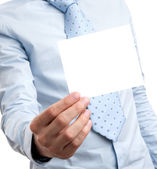 Business man holds a blank card — Stock Photo