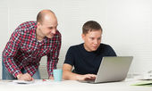 Two men with laptop at office — Stock Photo