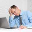 Worried business man with laptop in office — Stock Photo #12589554