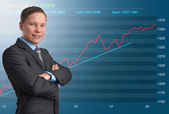 Business man and stock market graph — Stock Photo