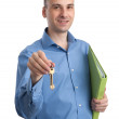 Real estate agent offering keys — Stock Photo