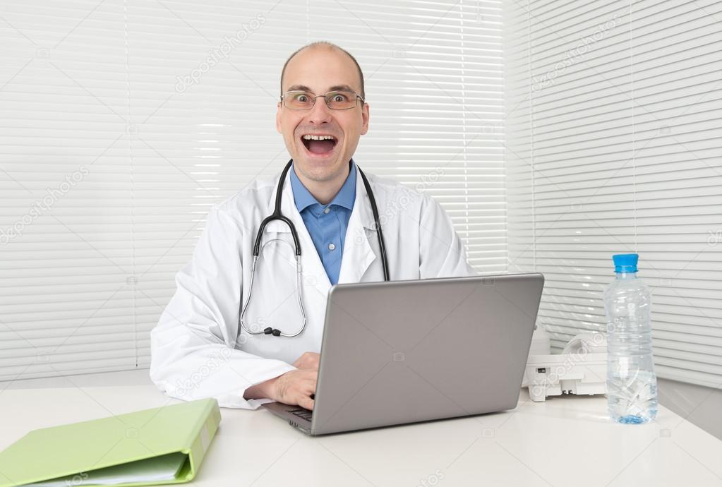 Funny doctor isolated over white  Foto de Stock   #12836256