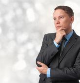 Uomo d'affari guardando lontano e pensare — Foto Stock