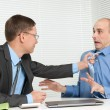 Business fighting at the desk in office — Stock Photo