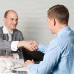 Businessmen shaking hands — Stock Photo #13720397