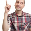 Handsome young man pointing up — Stock Photo