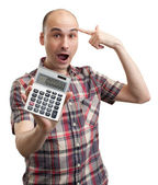 Shocked man with calculator — Stock Photo
