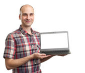 Smiling man with laptop computer — Stock Photo