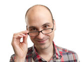 Young handsome man with smile wearing eyeglasses — Stock Photo