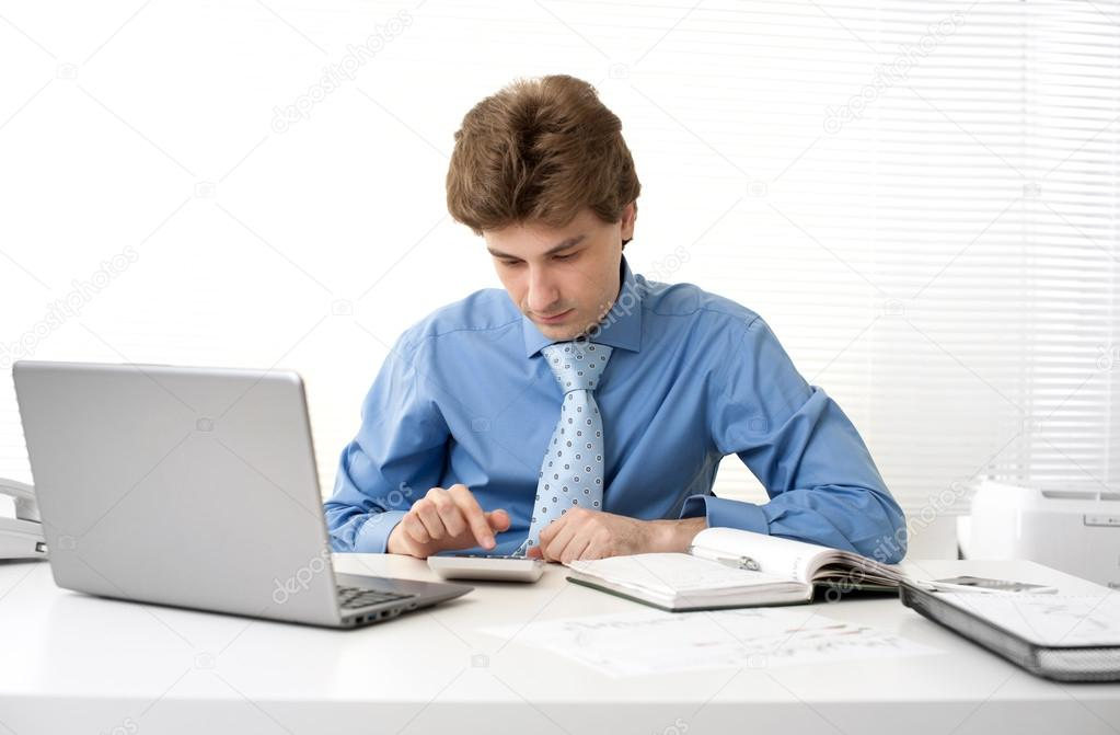 Business man working in his office — Stock Photo #14815643