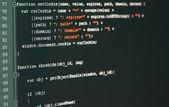 Código del programa en un monitor — Foto de Stock