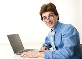 Handsome young business man with laptop — Stock Photo