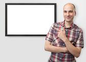 Man pointing finger on plasma tv — Stock Photo