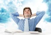 Businessman in cloud — Stock Photo