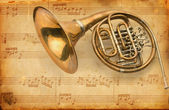 French horn. grunge musical background — Stock Photo