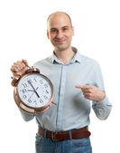 Man with an alarm clock — Stock Photo