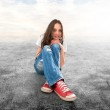 Young girl sitting on a floor — Stock Photo #21930957