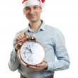 Man wearing a Santa hat with big clock — Stock Photo