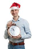 Muž klobouk santa s velkými hodinami — Stock fotografie