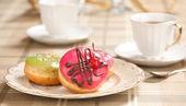 Tea cup and doughnuts — Stock Photo