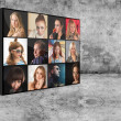 Digital wall with portraits — Stockfoto