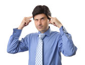 Handsome businessman doubting isolated over white background — Stock Photo